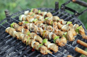 Grilled pork meat on stick, barbecued with vegetables - Stock Image